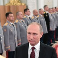 Putin takes part in Russian military drills, fires missiles